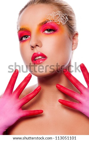 pretty woman with creative face art on white background - stock photo