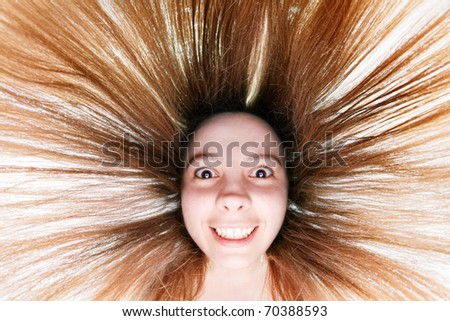 Pretty woman with dishevelled hair shot with fisheye - stock photo