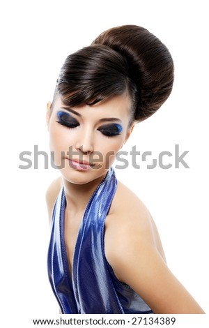 Pretty  woman with fashion hairstyle and multicolored make-up