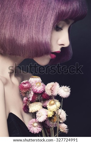 Pretty Woman with Fashion Hairstyle. Purple Coloring Hair. Make-up. Dried Flowers - stock photo
