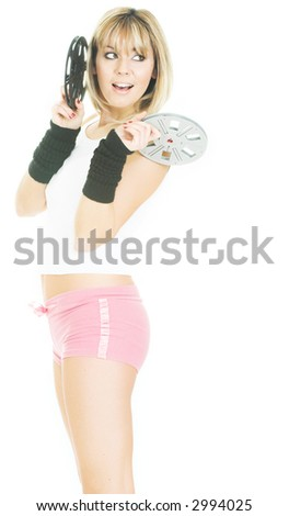 Pretty woman with film reels. Beautiful girl on white with movies isolated on white - stock photo