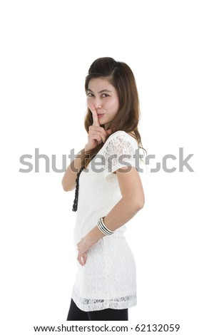 pretty woman with finger on her lips, isolated on white background - stock photo