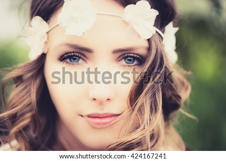 pretty woman with flower hair band in nature / Woman in nature - stock photo