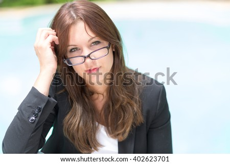 pretty woman with glasses outdoor