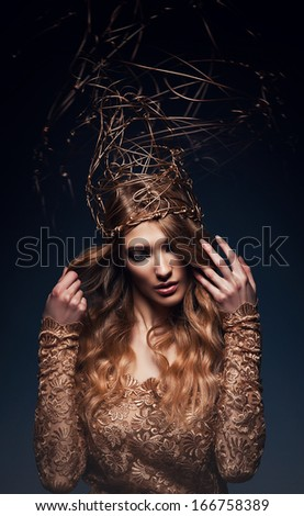 pretty woman with gold accessory on head - stock photo