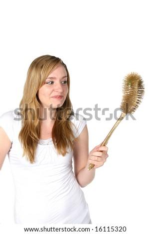pretty woman with golden toilet brush - stock photo
