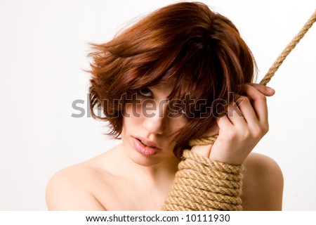 Pretty woman with her hands tied portrait on white - stock photo