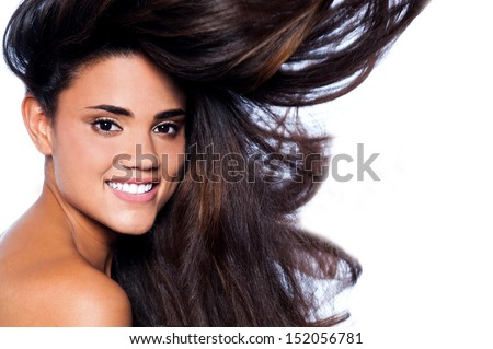 Pretty woman with long brown blowing hairs - stock photo