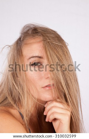 Pretty woman with long hair looking thoughtful
