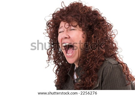 Pretty woman with long red curly hair screaming in frustration - stock photo