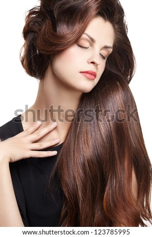 Pretty woman with long straight brown hair looking at camera - stock photo