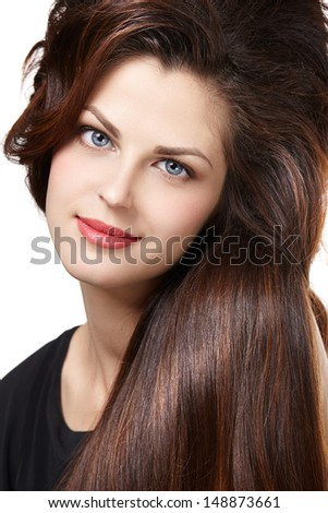 Pretty woman with long straight brown hair looking at camera