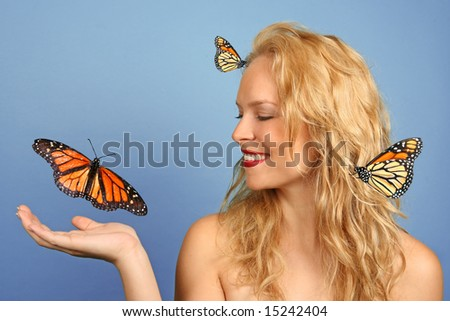 Pretty Woman With Many Butterflies on Blue Background - stock photo