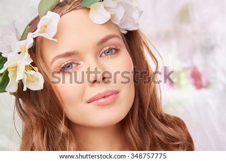 Pretty woman with natural make-up looking at camera - stock photo