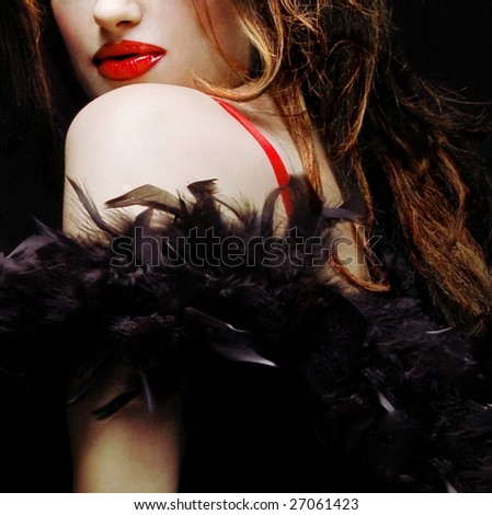Pretty woman with ostrich feathers - stock photo