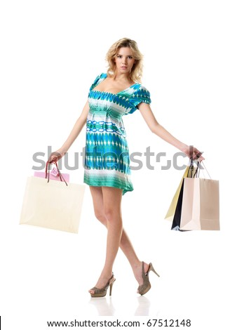 pretty woman with paper shopping bags