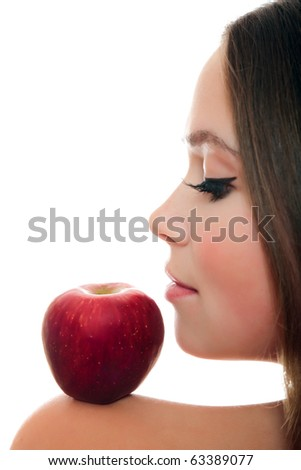 Pretty woman with red apple on her shoulder. - stock photo