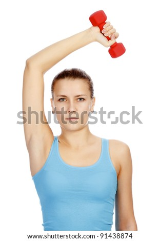 Pretty woman with red barbell posing against white background