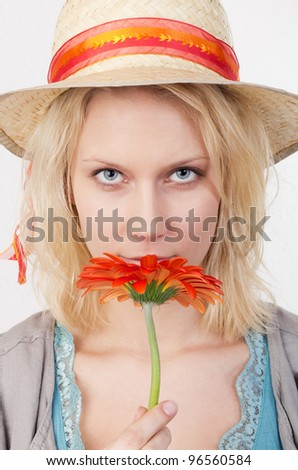 Pretty woman with red flower. Studio shot against a white background. - stock photo
