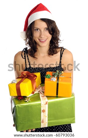Pretty woman with santa hat holding christmas present - stock photo