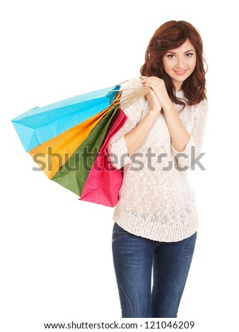 Pretty woman with shopping bags - stock photo