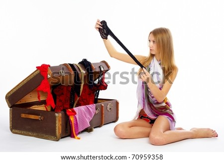 Pretty woman with suitcase - stock photo