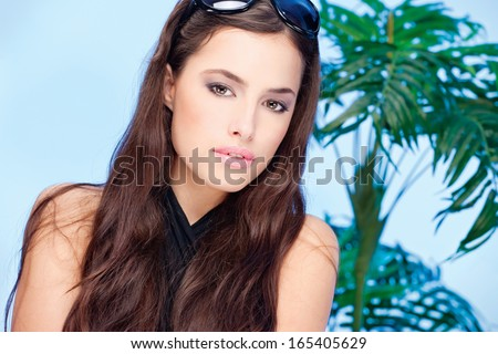Pretty woman with summer glasses in her long hair - stock photo