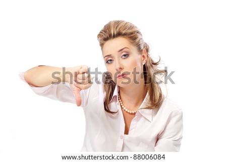 Pretty woman with thumb down on a white background - stock photo