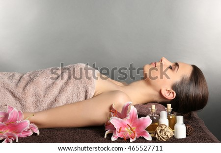 Pretty woman with towel lying on table