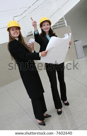 Pretty women architects  at the work site - stock photo