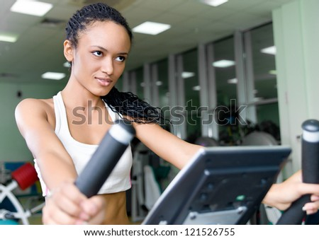 pretty women on the track  at the fitness club - stock photo