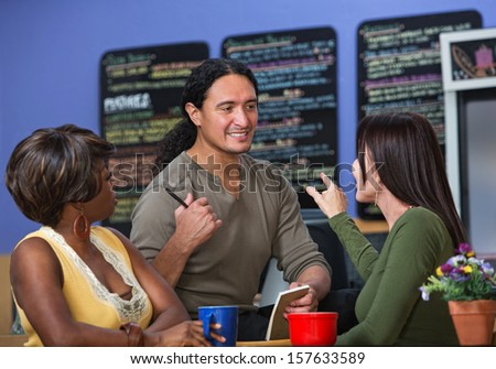 Pretty women ordering from server at a cafe