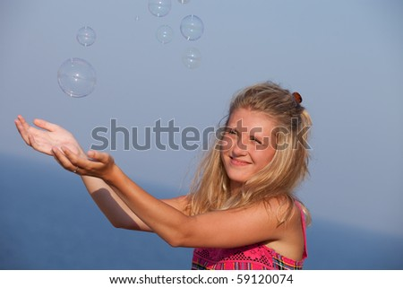 pretty women play with soap bubbles