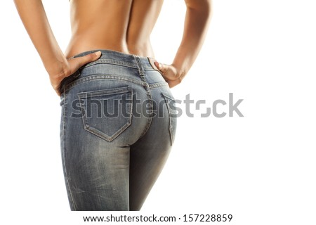 pretty women 's ass in tight jeans on white background - stock photo