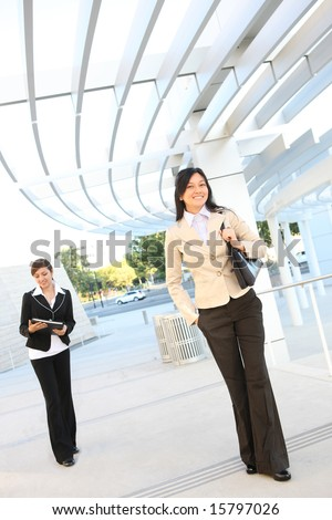 Pretty women walking to the office building to start work - stock photo