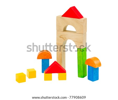 Pretty wooden mushroom cottage and tower that children creates from colorful toy blocks