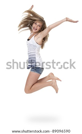 Pretty 14 year old girl jumping mid-air, isolated on white.