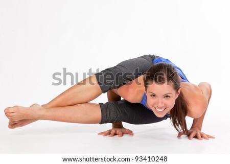 Pretty Yoga woman Sideways Crow Pose - stock photo