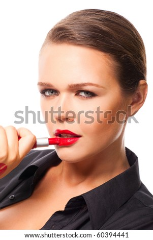 pretty young adult apply red lipstick isolated on white background - stock photo