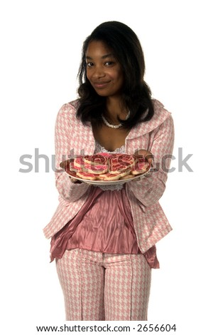 Pretty Young African American girl in a Herringbone suit with a plate of Valentine's Day cookies