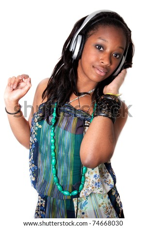 Pretty young african american girl listening to music - stock photo