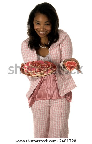Pretty young African American girl n a Herringbone suit with a plate of Valentine's Day cookies