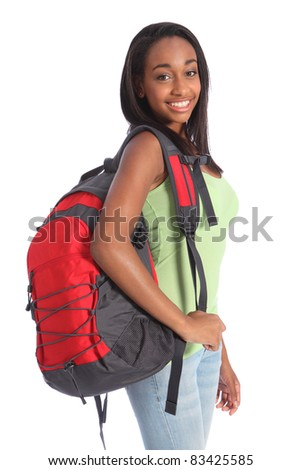Pretty young African American teenager school girl, with long black hair wearing green t-shirt and red school backpack with happy smile. Studio shot against white background. - stock photo