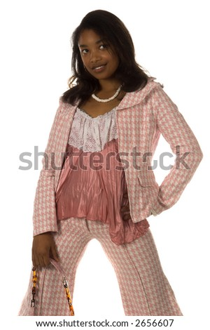 Pretty young African American woman dressed in a pink herringbone business suit  and holding a leather purse - stock photo