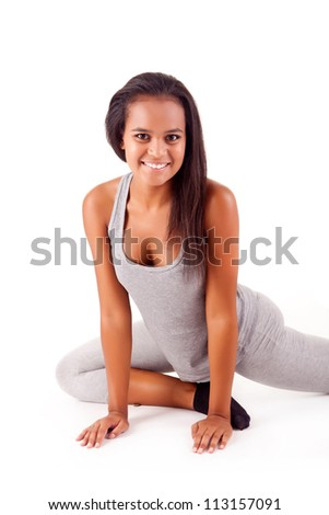 Pretty young african woman doing exercise