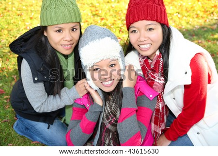 Pretty young asian girls in the park during autumn