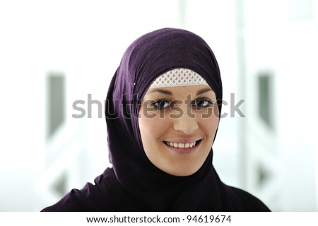 Pretty young Asian Muslim woman - stock photo