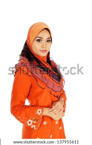 Pretty young Asian Muslim woman posses beautiful in action. Islamic fashionable attire concept - stock photo
