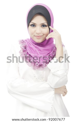 Pretty young Asian Muslim woman smile in action. - stock photo
