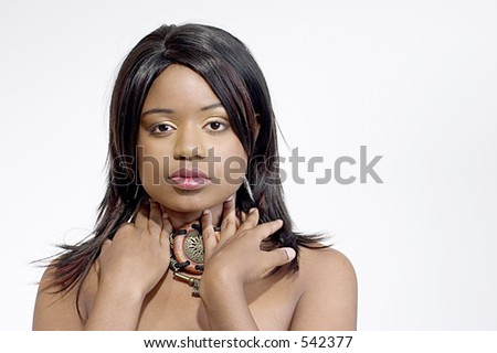 Pretty young black woman wearing a wood choker - stock photo